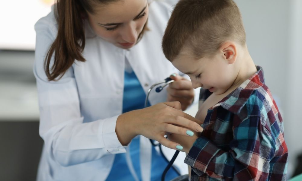 Doctor treating child patient